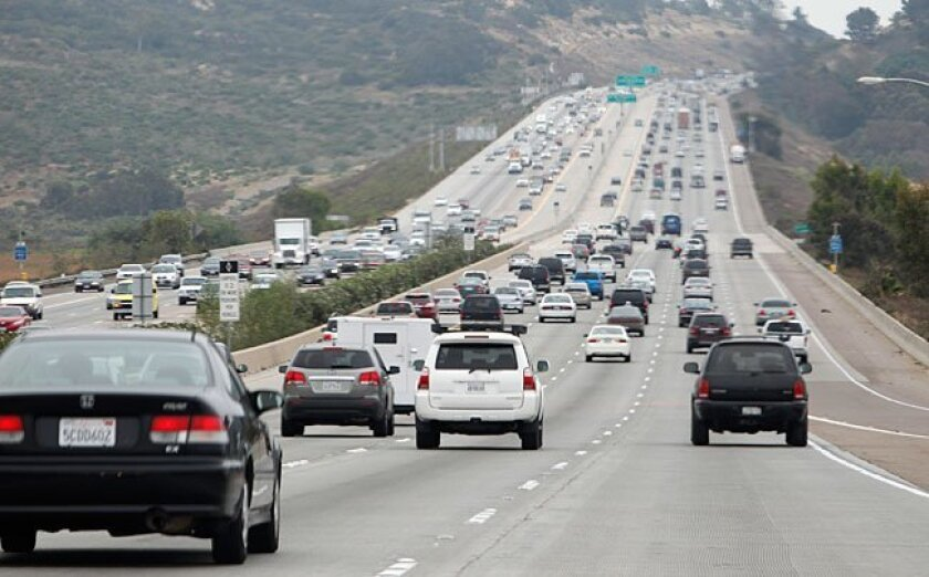 Traffic heads south on Interstate 5 past Via De La Valle.