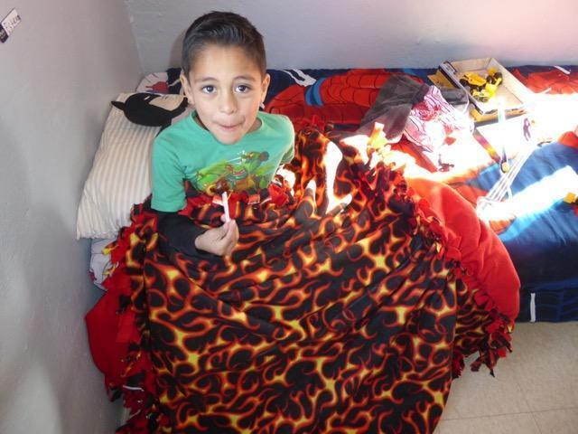 Miguel with a blanket.