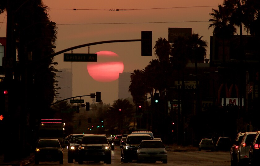 The sun sets on Whittier Boulevard in East Los Angeles.
