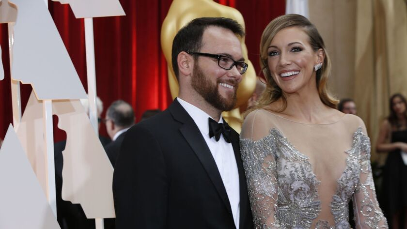 Producer Dana Brunetti and actress Katie Cassidy arrive at the 87th Annual Academy Awards at the Dolby Theatre.