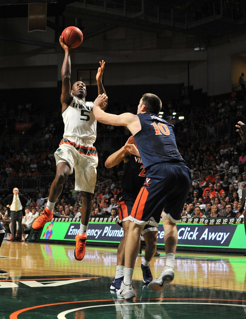 Miami's Davon Reed goes up to shoot against Virginia's Mike Toby during the first half action of an NCAA college basketball game in Coral Gables, Fla., Monday, Feb. 22, 2016. (AP Photo/Gaston De Cardenas)