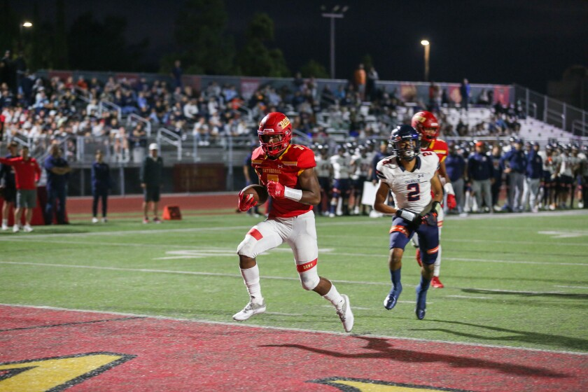 Cathedral Catholic's Lucky Sutton scores the first points of the game from 12 yards out against Mission Hills Chaminade.