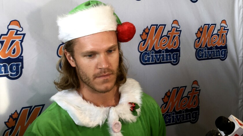 Mets baseball pitcher Noah Syndergaard speaks to reporters during the Mets' annual Kids Holiday Party at Citi Field in New York on Thursday.
