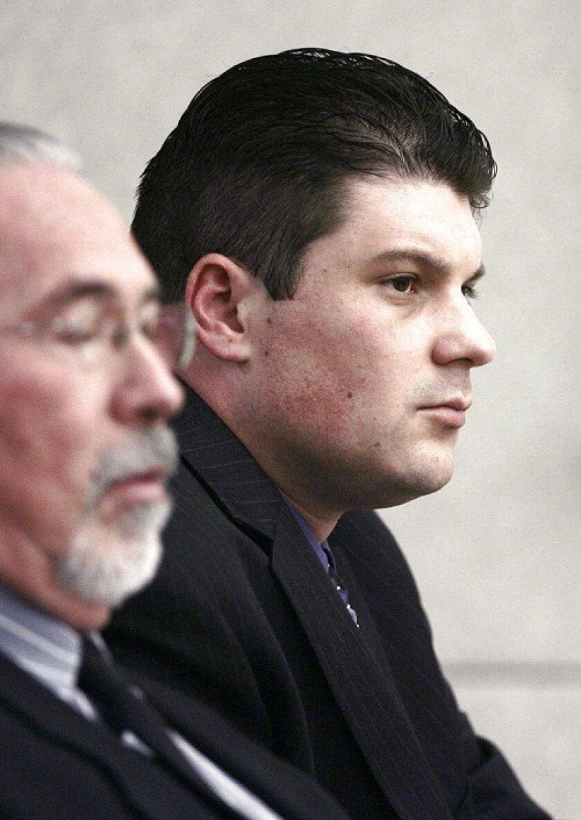 Frank White, right, sits next to investigator Charles B. Battle as they listen to opening arguments.