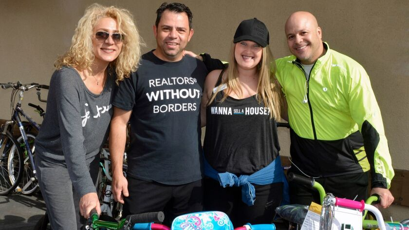 Karol Kochova, from left, Harry Timuryan, Courtney Korb and Robert Clark were among the local Realtors who made last Saturday's fifth annual bike drive a success.