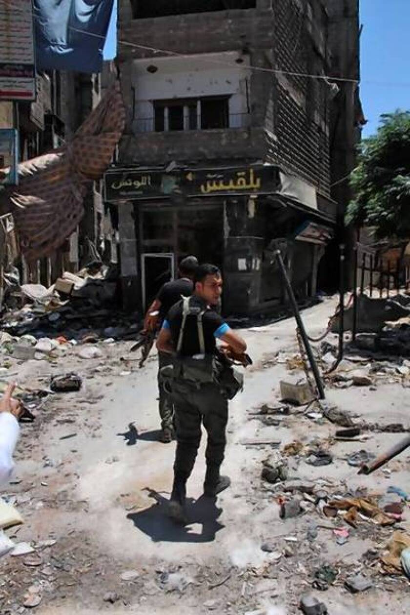 In Syria, battle for Damascus is also waged in suburbs