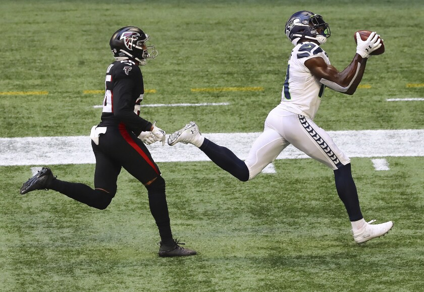 Seattle Seahawks wide receiver DK Metcalf catches a touchdown pass past Atlanta Falcons cornerback Isaiah Oliver during the second half of an NFL football game on Sunday, Sept. 13, 2020, in Atlanta. (Curtis Compton/Atlanta Journal-Constitution via AP)