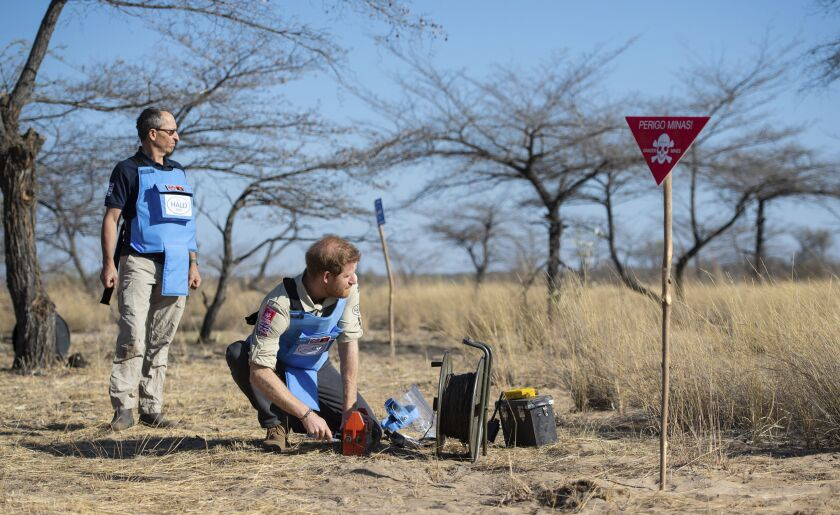 Britain's Prince Harry remotely detonates a land mine at a minefield in Dirico, Angola.