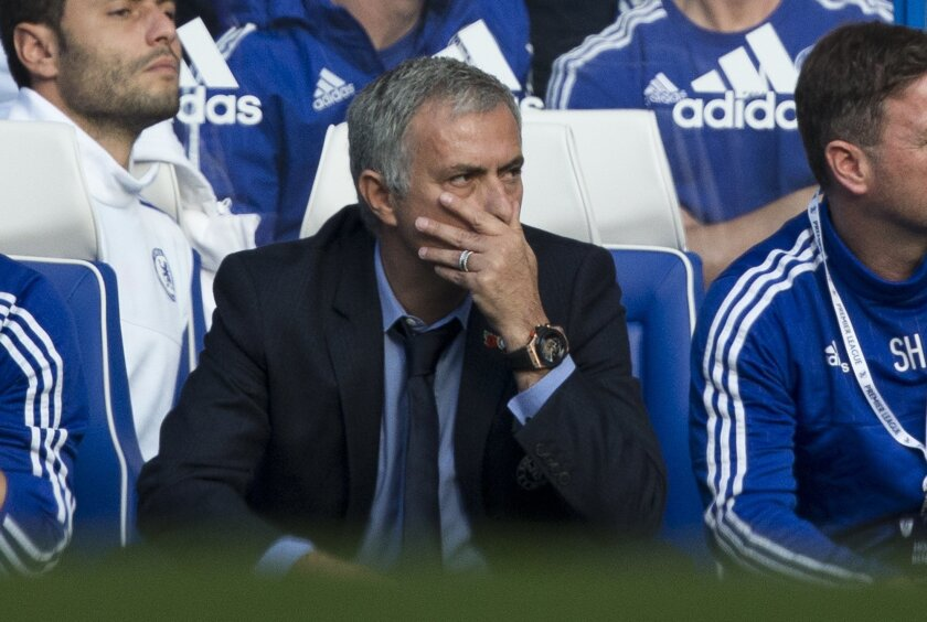 Chelsea's head coach Jose Mourinho watches during the English Premier League soccer match between Chelsea and Liverpool at Stamford Bridge stadium in London, Saturday, Oct. 31, 2015.  (AP Photo/Matt Dunham)