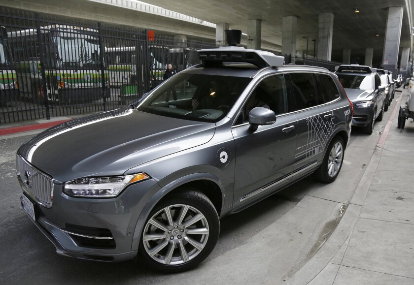 An Uber self-driving car heads out for a test drive in San Francisco. Hours after Uber launched the self-driving service Wednesday, California's Department of Motor Vehicles warned that it was illegal because the cars did not have a special permit.