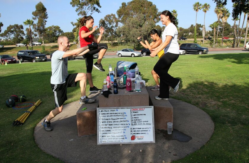 As part of a boot camp run by Bryan Schuler at Mission Bay Park, participants work on the bench step-up. From left, they are Daniel Hahn, Maggie Hannon, Christina Rodriquez and Lisa Schultz.