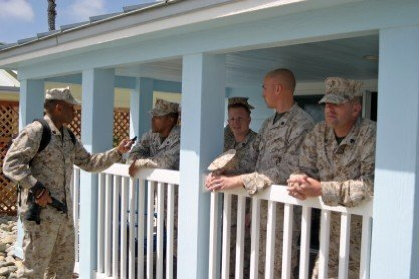 Camp Pendleton service members check out one of the new cottages installed on June 18.