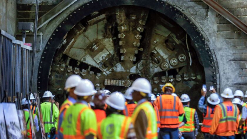 A tunnel-boring machine deployed on the Crenshaw/LAX light rail construction project breaks through at the underground Leimert Park Station in Los Angeles.