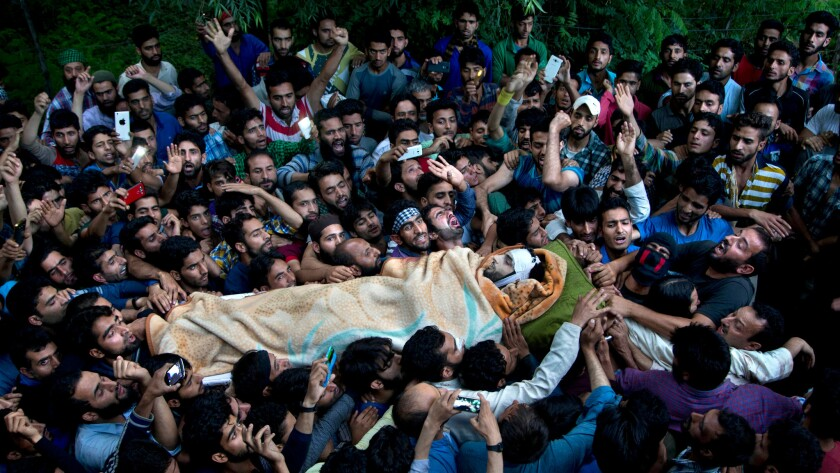 Supporters carry the body of militant leader Burhan Wani during a funeral procession in Tral, in Indian-administered Kashmir, on July 9.
