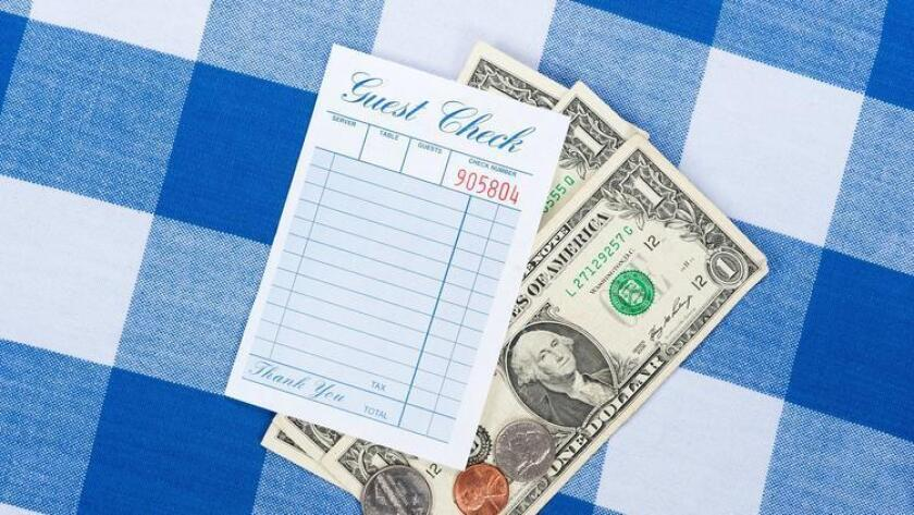 What are your thoughts on tipping at restaurants? (/ Shutterstock.com)