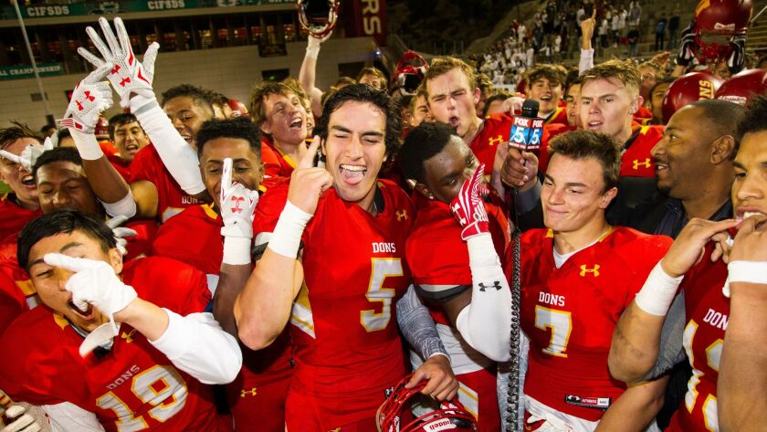 Cathedral Catholic's Moroni Anae (5) cheers with teammates after the Dons won the Open Division title.