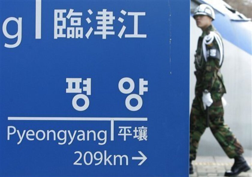 A South Korean Army soldier walks by a signboard showing distances to North Korea's capital Pyongyang from Imjingang railway station near the demilitarized zone (DMZ) of Panmunjom, South Korea, in Imjingak, north of Seoul, South Korea, Friday, Jan. 30, 2009. North Korea said Friday it is ditching a nonaggression pact and all other peace agreements with South Korea, escalating tensions between the wartime rivals in a move seen as a possible prelude to an armed provocation. (AP Photo/Ahn Young-joon)