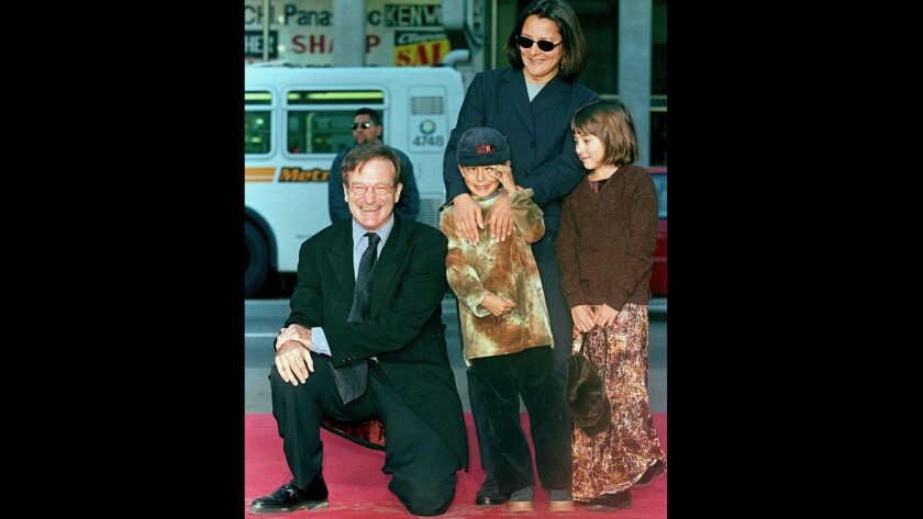 Robin Williams with son Cody, center, daughter Zelda and then-wife Marsha Garces in December 1998 at the actor's handprint and footprint ceremony on Hollywood Boulevard. Son Cody Williams joined his mom and older siblings Tuesday in issuing statements the comic-actor.