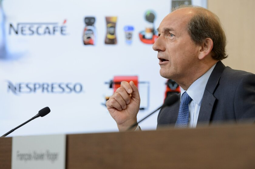 Nestle CEO Paul Bulcke speaks during the 2015 full-year results press conference of Nestle in Vevey, Switzerland, Thursday, Feb. 18, 2016. Nestle reported net income fell to 9.07 billion Swiss francs (US dollar 9.15 billion), from 14.46 billion Swiss francs a year earlier, citing the re-evaluation