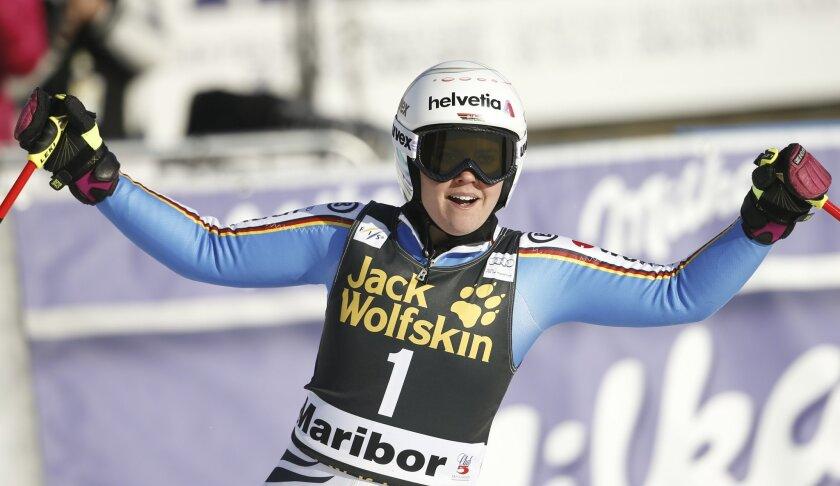 Germany's Viktoria Rebensburg celebrates after winning an alpine ski, women's World Cup giant slalom, in Maribor, Slovenia, Saturday, Jan. 30, 2016. (AP Photo/Marco Trovati)