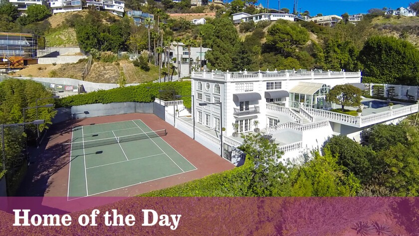 A sunken tennis court and wide terraces are among the features at this European-inspired villa in Hollywood Hills West.