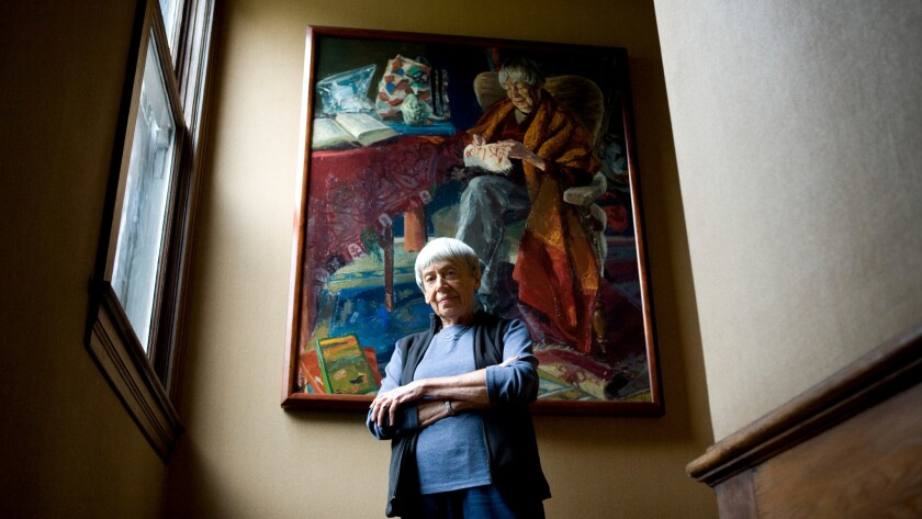 Celebrated science–fiction and fantasy writer Ursula K. Le Guin poses in front of a portrait painted by Henk Pander.