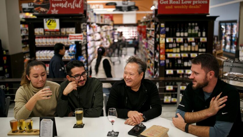 Carolyne Green, Allan Reyes, Jerry Wong and Eric Holm socialize at a bar inside the Ralphs grocery store in downtown L.A.