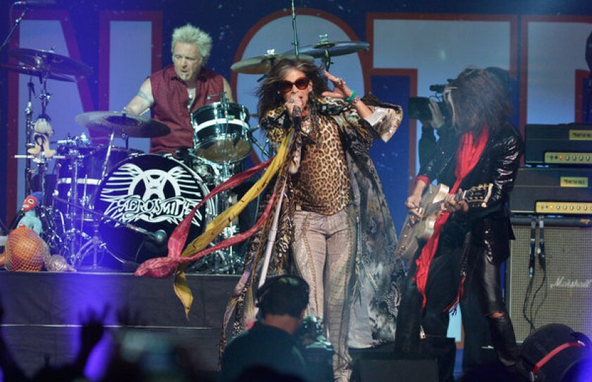 Steven Tyler and Aerosmith perform during the Boston Strong concert Thursday night at TD Garden.