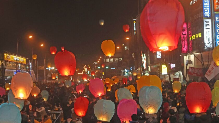 Protesters release paper lanterns into the air during a rally Saturday in Chuncheon, South Korea, calling for South Korean President Park Geun-hye to step down.