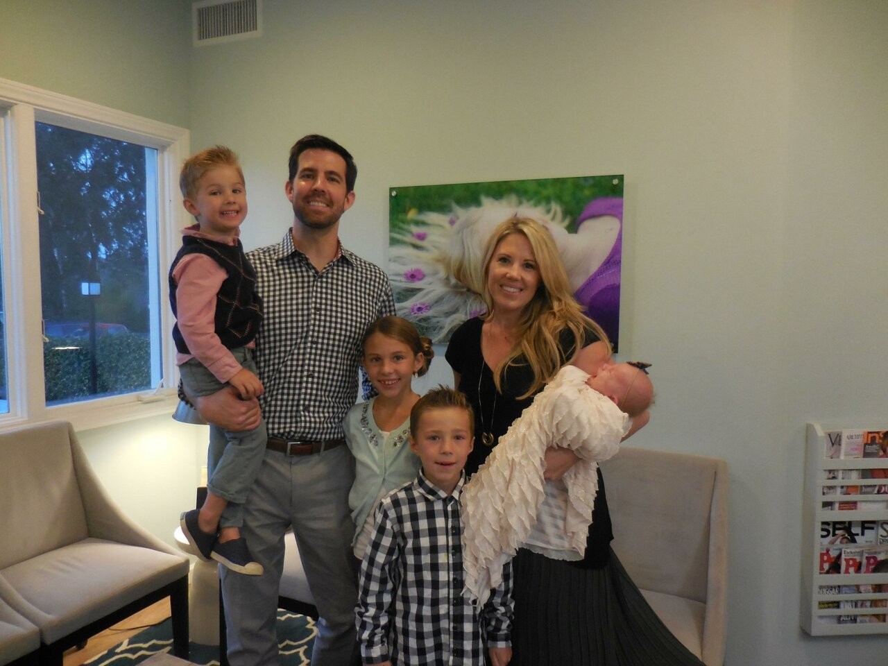 Dr. Weston Spencer and his wife Ashley Spencer with their four children.