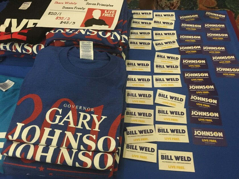 Merchandise on display for former New Mexico Gov. Gary Johnson and former Massachusetts Gov. Bill Weld, who are running for the presidential and vice-presidential nomination, respectively, at the Libertarian Party Convention in Orlando, Fla.