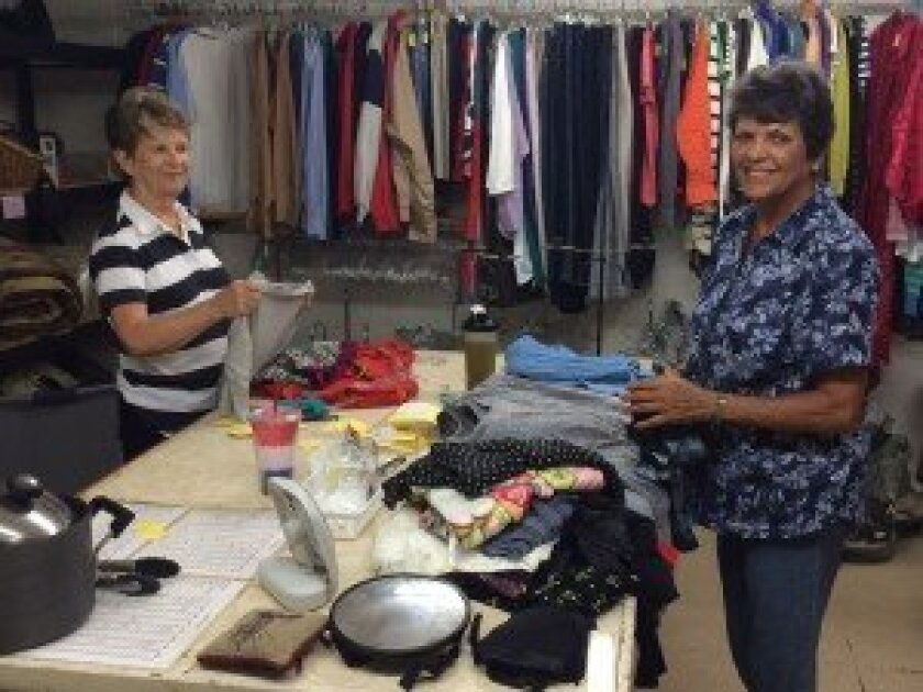 Rancho Santa Fe Garden Club Resale Shoppe volunteers sort through the latest donations. Photo by Karen Billing