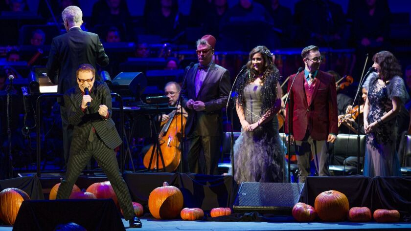 """LOS ANGELES, CA - OCTOBER 31, 2015: Danny Elfman sings with the chorus during the """"Nightmare Before"""
