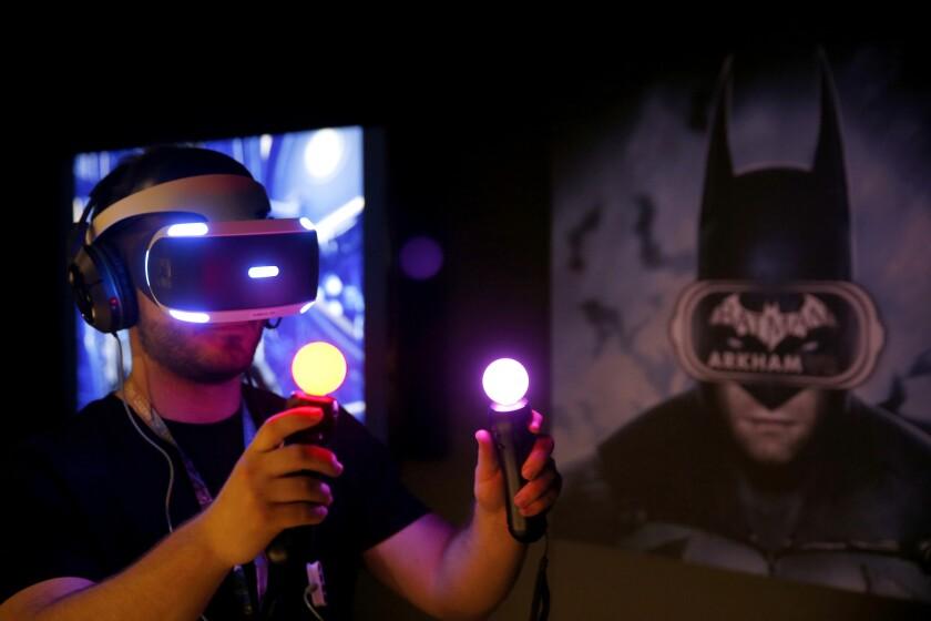 "Jordan Maron plays Warner Bros. Interactive and DC Entertainment's ""Batman: Arkham VR"" during the Electronic Entertainment Expo."