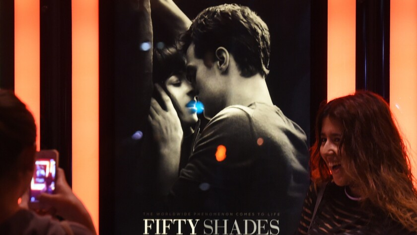 """Nearly 70% of """"Fifty Shades"""" moviegoers through Sunday were female. The movie racked up $94 million in domestic ticket sales since its Friday opening."""