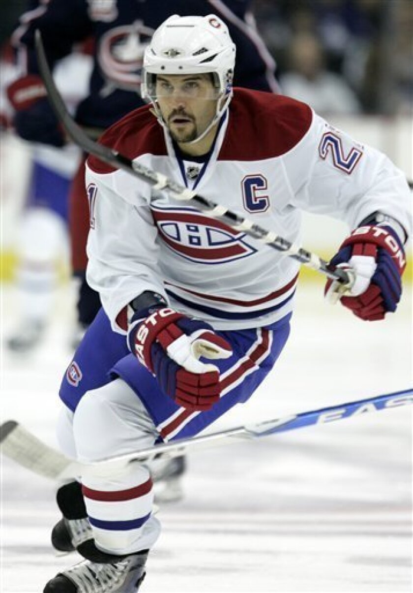 Montreal Canadiens' Brian Gionta skates up ice in the first period of an NHL hockey game against the Columbus Blue Jackets in Columbus, Ohio, Tuesday, Nov. 2, 2010. Gionta is only the second US-born player to be captain of the Canadiens. (AP Photo/Paul Vernon)