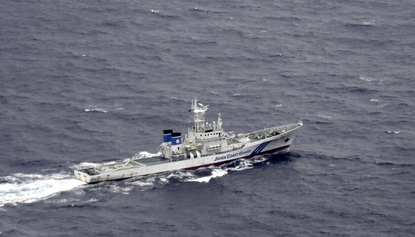 In this aerial photo, Japan's Coast Guard ship is seen at sea during a search and rescue operation f