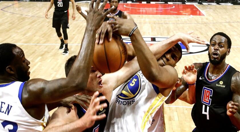 LOS ANGELES, CA, SUNDAY, APRIL 21, 2019 - Clippers forward Danilo Gallinari battles Warriors center