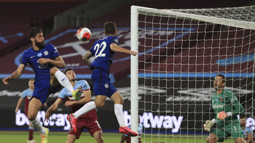 Chelsea's Olivier Giroud, left heads the ball towards goal during the English Premier League soccer match between West Ham United and Chelsea at the London Stadium in London, Wednesday, July, 1, 2020. (Adam Davy/Pool via AP)