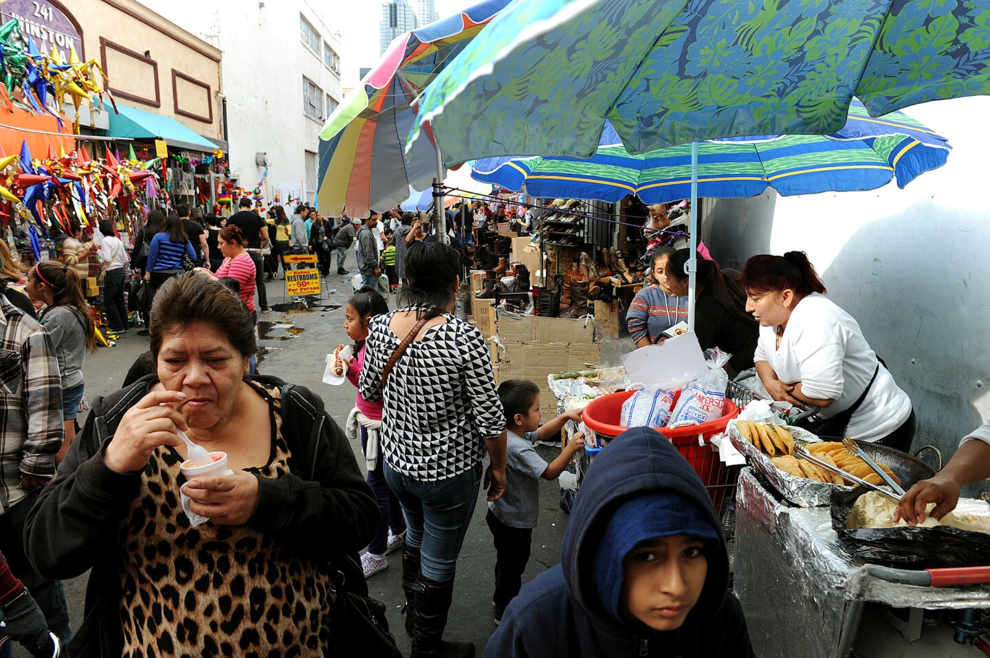 Street vendors, including Margarita Tinoco, right, sell food in an alley off of Fourth Street in downtown Los Angeles.