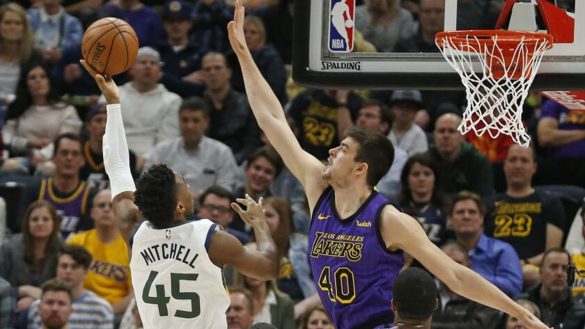 Jazz guard Donovan Mitchell has his shot challenged by Lakers center Ivica Zubac during the first half Friday.