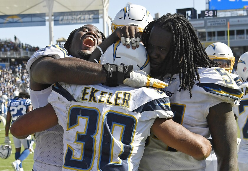Chargers running back Austin Ekeler celebrates with teammates.