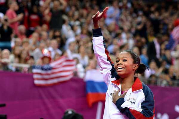 Gabrielle Douglas waves to the crowd after winning the gold medal in the women's individual all-around. She's just the fourth U.S. woman to win the title.