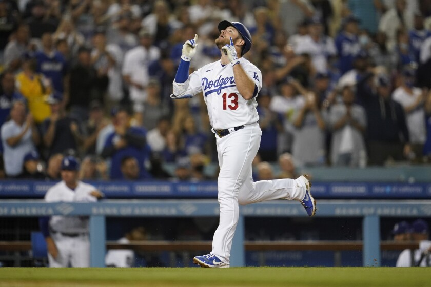 Dodgers first baseman Max Muncy celebrates after hitting a two-run home run in the third inning Tuesday.