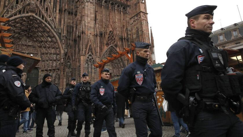 French police officers patrol outside the cathedral as the Christmas market reopens in Strasbourg, France, on Dec. 14.