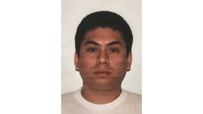 Booking photo of LAPD Officer Robert Cain, 31.