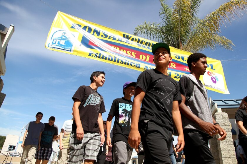 Students at Bonsall High School walk beneath the banner announcing their school.