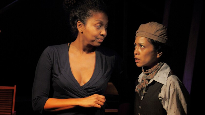 "A maid (Leilani Smith) counsels a disguised outsider (Amielynn Abellera) on the multicultural universe of ""Twelfth Night."""