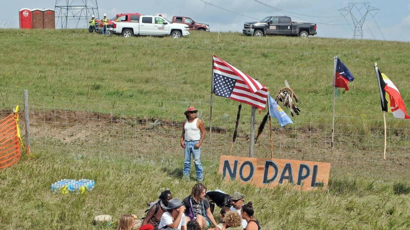 Bill Left Hand, of McLaughlin, South Dakota, stands next to a sign at the site of an Aug. 12 protest against construction of the Dakota Access Pipeline.