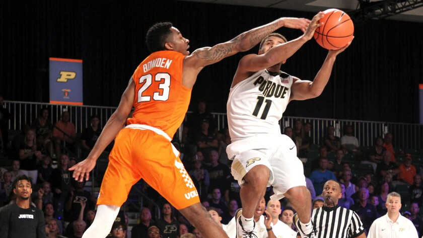 Purdue guard P.J. Thompson (11) drives to the basket guarded by Tennessee guard Jordan Bowden (23) d